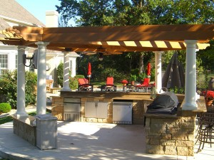 outdoor kitchen with pergola and arbors